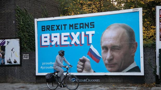 A billboard featuring Russian leader Vladamir Putin, in Hackney, east London (PA)