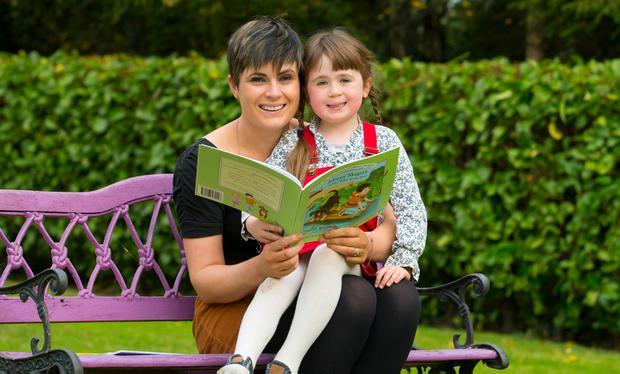 Raising funds: Emma-Jane Leeson launches her new Johnny Magory book with daughter Layla to help CMRF Crumlin. Photo: Patrick Browne