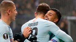 Teammates congratulate teammate Oliver Giroud after he scored for Chelsea. Photo: AP/Sergei Grits