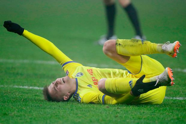 Bate's Zakhar Volkov lies on the pitch after being fouled. Photo: AP