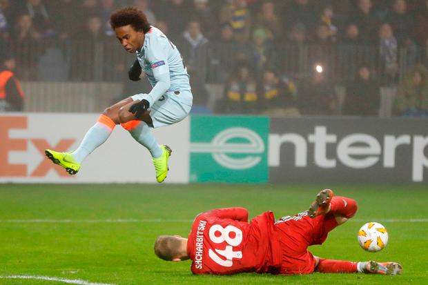 Chelsea's Willian jumps to avoid a collision with Bate goalkeeper Denis Scherbitski. Photo: AP