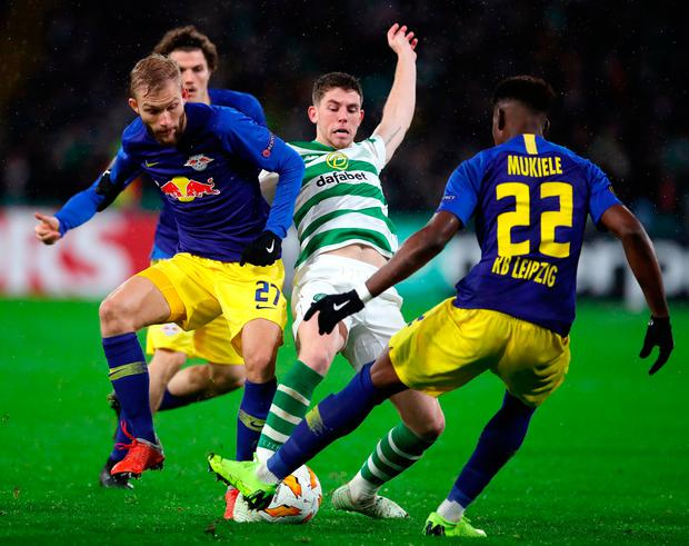 Ryan Christie of Celtic battles with Konrad Laimer and Nordi Mukiele of RB Leipzig. Photo: Ian MacNicol/Getty Images