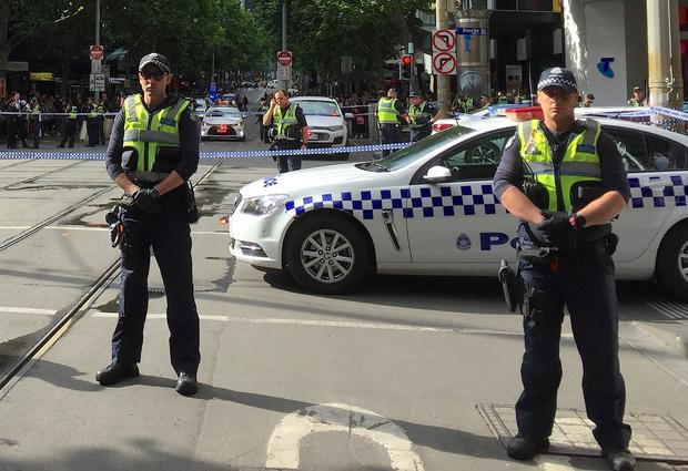 Policemen block members of the public from walking towards the Bourke Street mall in central Melbourne Australia