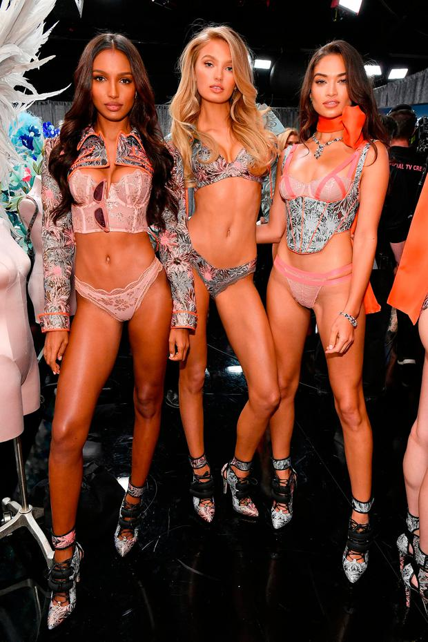 (L-R) Jasmine Tookes, Romee Strij and Shanina Shaik pose backstage during the 2018 Victoria's Secret Fashion Show at Pier 94 on November 8, 2018 in New York City. (Photo by Dia Dipasupil/Getty Images for Victoria's Secret)