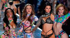 from L to R : Canadian model Winnie Harlow, US model Gigi Hadid, US model Kendall Jenner and British model Alexina Graham walks the runway at the 2018 Victoria's Secret Fashion Show on November 8, 2018 at Pier 94 in New York City