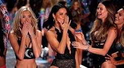 Model Adriana Lima reacts beside other models while presenting a creation during the 2018 Victoria's Secret Fashion Show in New York City, New York, U.S., November 8, 2018. REUTERS/Mike Segar