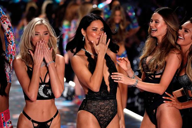 fce5b2020050 Model Adriana Lima reacts beside other models while presenting a creation  during the 2018 Victoria's Secret