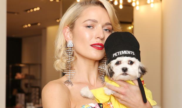 Teo wears Saint Laurent earrings €1,595, and Richard Quinn strapless gown €2,720, pictured with Coco wearinga beanie €18 & top €30 by Petements at Brown Thomas