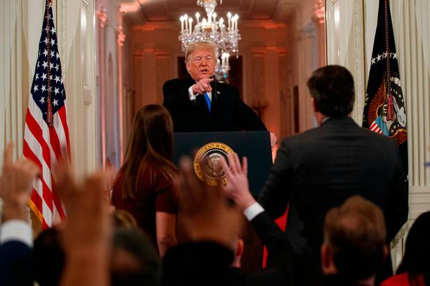 Accosted: President Donald Trump speaks to CNN journalist Jim Acosta on Wednesday Acosta was later stripped of his White House pass. AP Photo/Evan Vucci