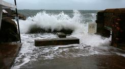 Waves break at the bathing area at Sandycove.Picture Credit:Frank McGrath 9/11/18