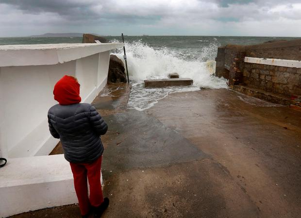 Watching the waves break at the bathing area at Sandycove.Picture Credit:Frank McGrath 9/11/18