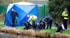 Murder probe: Members of the Garda Sub Aqua Unit at the scene near Ardclough, Co Kildare, where Paul Wells admitted dumping the body of Kenneth O'Brien in the Grand Canal. Photo: PA