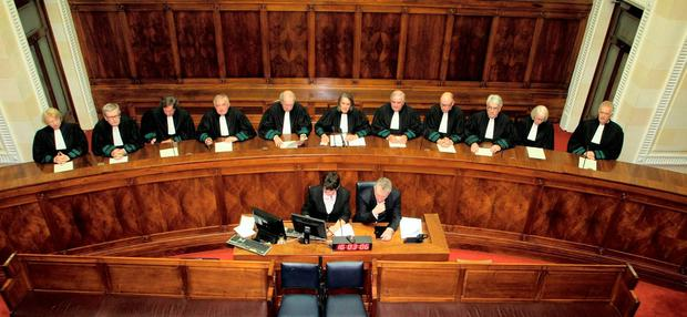 Riposte: Supreme Court judges including Mr Justice Adrian Hardiman (fourth from left), who issued a stunning response when Michael McDowell took aim at the judiciary in 2012. Photo: Courtpix