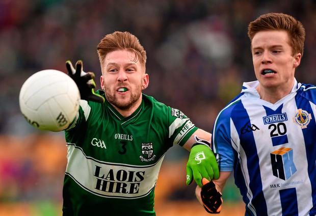 Cahir Healy battles for possession with Robbie McDaid of Ballyboden St Enda's in the 2015 Leinster Club SFC final. Photo: Sportsfile