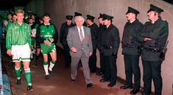 Northern Ireland captain Alan MacDonald and his Republic counterpart Andy Townsend lead out the teams under the watchful eyes of the RUC. Photo: Sportsfile