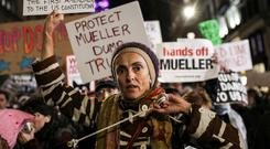 People took part in a protest in New York City to protect the investigation led by Special Counsel Robert Mueller after the appointment of Matt Whitaker as acting attorney general. Photo: Jeenah Moon/Reuters