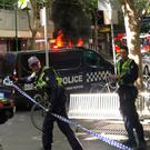 A man went on a stabbing spree in the centre of Melbourne yesterday after apparently setting a car alight, killing one person and bringing the city to a standstill