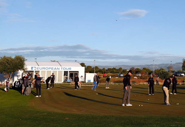 Players warm up on the putting green ahead of the first day of play at the final stage of the European Tour Qualifying Schools yesterday. Photo: Getty Images
