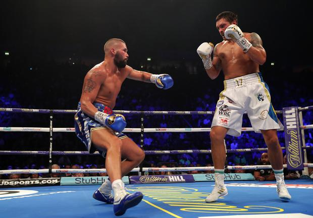 MANCHESTER, ENGLAND - NOVEMBER 10: Tony Bellew of England slips as Oleksandr Usyk of Ukraine looks on during the WBC, WBA, WBO, IBF & Ring Magazine World Cruiserweight Title Fight between Oleksandr Usyk and Tony Bellew at Manchester Arena on November 10, 2018 in Manchester, England. (Photo by Richard Heathcote/Getty Images)