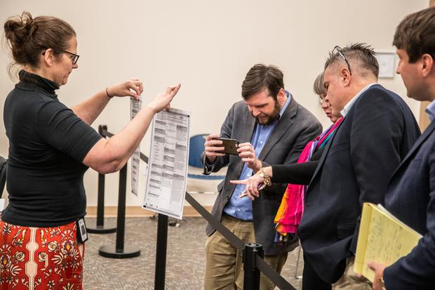 Leon County Supervisor of Elections employee, Holly Thompson, shows an original ballot and one remarked by the canvassing board to allow the ballot to be machine counted (Photo by Mark Wallheiser/Getty Images)