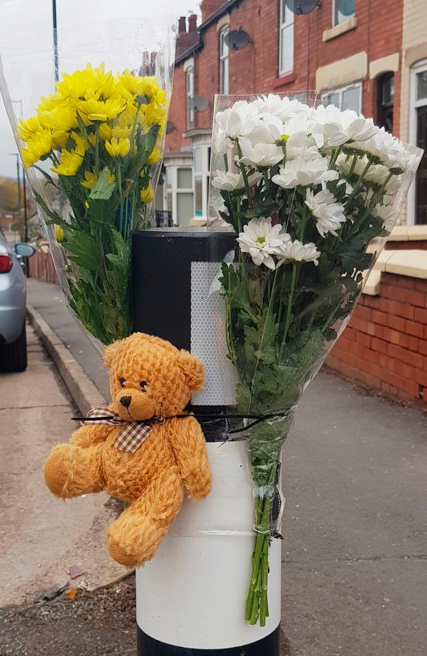 Tributes left at the scene where three adults and a one-year-old child died in a car crash Photo credit should read: Dave Higgens/PA Wire
