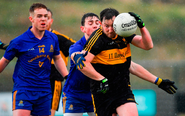 Daithí Casey of Dr Crokes in action against Colm Keane and Eoin McGreevey, behind, of St Finbarr's