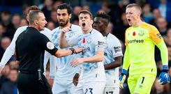 Everton's Seamus Coleman, Jordan Pickford and team mates remonstrate with referee Kevin Friend