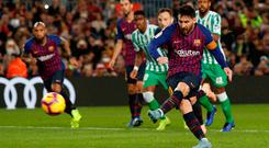 Barcelona's Lionel Messi scores their first goal from the penalty spot