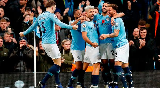 Manchester is Blue as Pep Guardiola's men go top of the table with victory over arch rivals