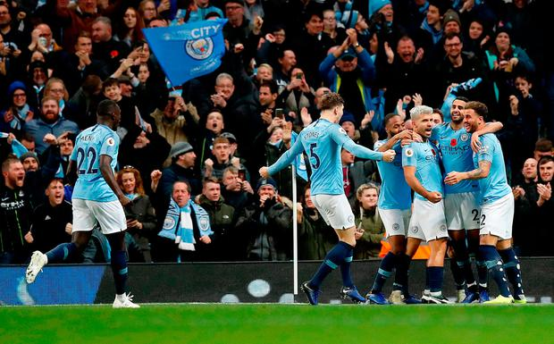 Manchester City's Sergio Aguero (third right) celebrates scoring his side's second