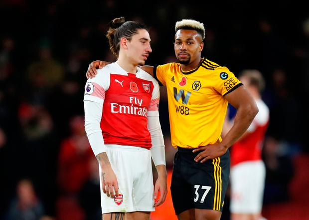 Arsenal's Hector Bellerin and Wolverhampton Wanderers' Adama Traore after the match