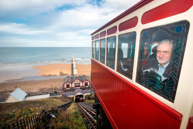 Britain's Work Co-ordinator Jeremy Corbyn rides Saltburn Cliff Lift, a railroad, during his visit to Saltburn-by-the-Sea, North Yorkshire on Saturday. Photo: Danny Lawson / PA Wire