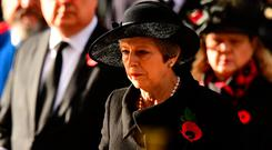Britain's Prime Minister Theresa May prepares to lay a wreath at a National Service of Remembrance at the Cenotaph in Westminster, London. Photo: Victoria Jones/ Pool via REUTERS