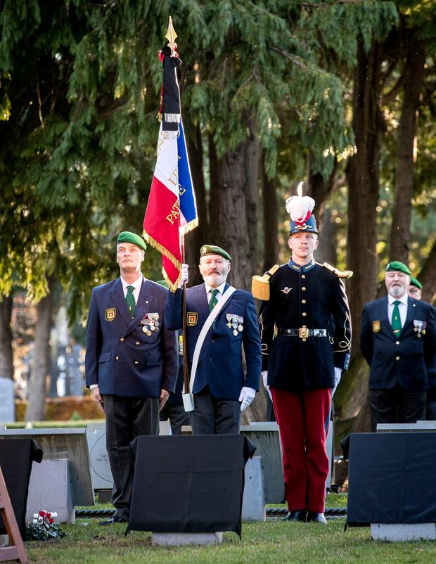 French Foreign Legion members Phil Hamilton, left and Christy Browne with Second Lt Philippe Jovanovic at Glasnevin cemetery. Photo: Iain White/Fennell Photography