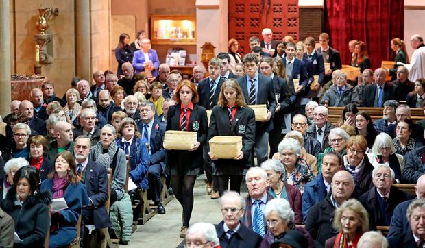 Students carry telegrams with the names of Cork war victims at a ceremony at St Fin Barre's Cathedral, Cork. Photo: Jim Coughlan