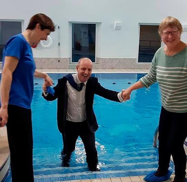 Government leak: Jim Daly is helped from the Wild Atlantic Pool in Baltimore after falling in. Photo: Anne Minihane/Southern Star
