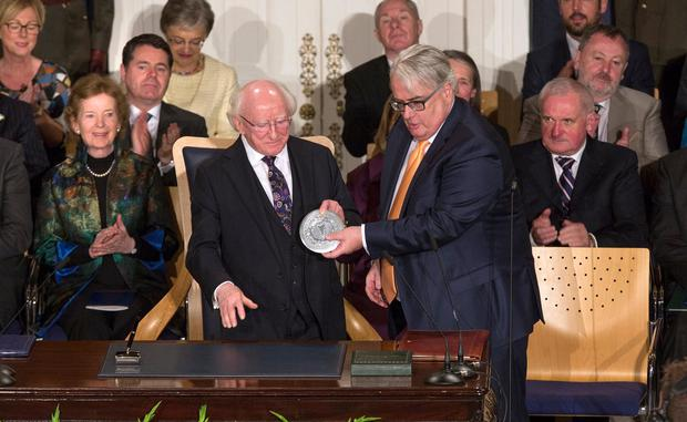 President Michael D Higgins receives his seal of office from Chief Justice Frank Clarke at his inauguration at Dublin Castle. Photo: Tony Gavin