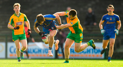 Ultan Harney of Clann na nGael is tackled by Corofin's Cathal Silke in their Connacht SFC semi-final. Photo by Ramsey Cardy/Sportsfile