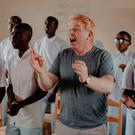 Singer and Bóthar ambassador Tommy Fleming singing with high school students. Photo: Sean Curtin