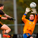 St Finbarr's goalkeeper John Kerins can do little to prevent Micheál Burns palming home Dr Crokes' fourth goal. Photo by Piaras Ó Mídheach/Sportsfile