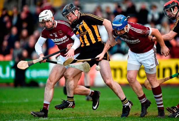 Patrick Hughes of Ballycran in action against Eunan McKillop, left, and Paddy McGill of Cushendall Ruairi Óg. Photo by Oliver McVeigh/Sportsfile