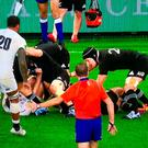 England substitute Courtney Lawes (20) is deemed to be in an offside position moments before blocking the kick of TJ Perenara (right). What could have been a match-winning try from Sam Underhill was subsequently disallowed.