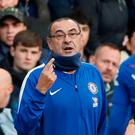 Chelsea manager Maurizio Sarri speaks with Jorginho and Willian. Photo: Reuters