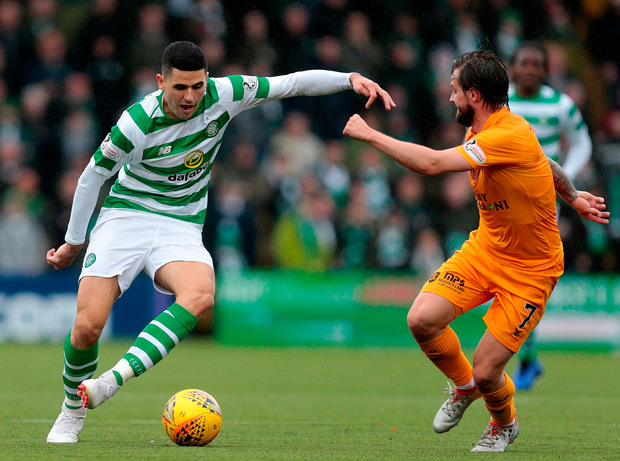 Livingston's Keaghan Jacobs (right) vies with Celtic's Tom Rogic. Photo: PA