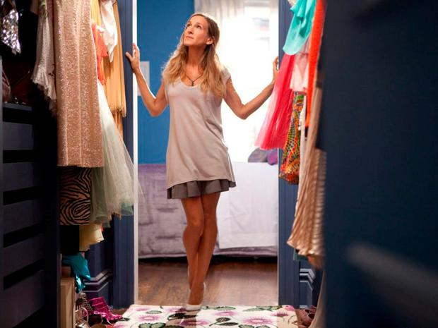 Carrie from Sex And The City stares into her wardrobe, which wellness experts believe is a vulnerable place that can have an impact on your mood for the rest of the day