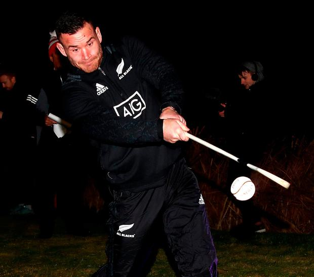 New Zealand's Ryan Crotty during a hurling skills competition with members of the Dublin football team yesterday. Photo: Phil Walter/Getty Images