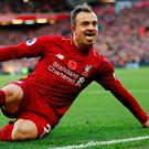 Xherdan Shaqiri celebrates after his goal against Fulham on Sunday which maintained Liverpool's title push. Photo: Reuters
