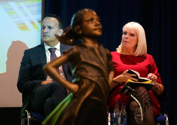 Taoiseach Leo Varadkar with Higher Education Minister Mary Mitchell O'Connor and the statue of the Fearless Girl at the gender action plan launch. PHOTO: DAMIEN EAGERS