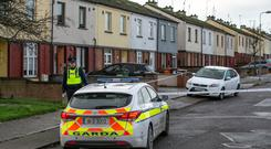 Feud: Gardaí sealed off the scene in the Moneymore Estate in Drogheda, Co Louth, yesterday