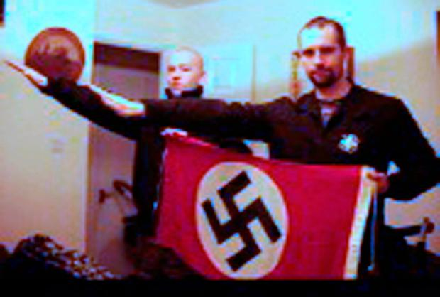 Undated handout file photo issued by West Midlands Police of Darren Fletcher (right) who admitted being a member of banned far-right terrorist group National Action, posing with Adam Thomas, as both give a Nazi-style salute. Thomas, 22, and his partner Claudia Patatas, 38, have been found guilty of being members of the extreme right-wing organisation National Action, which was banned in 2016.West Midlands Police/PA Wire